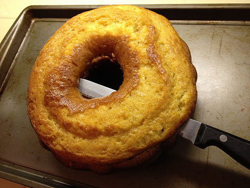 cutting rum cake in half