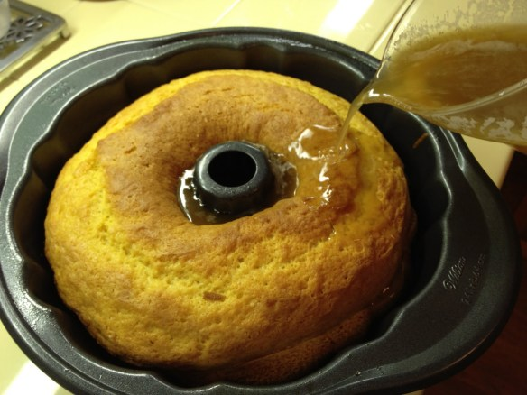 pouring glaze on rum cake