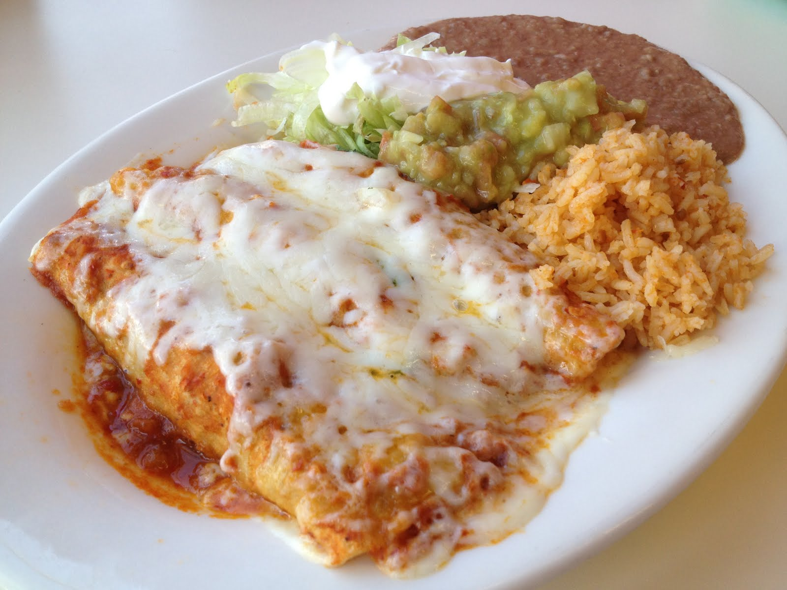 Enchiladas With Rice And Beans Combo enchilada platter
